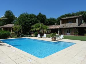 The swimming pool at or near Le Mas du Péré