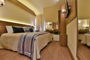 A bed or beds in a room at Hotel Due Nobili