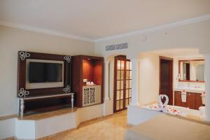 A television and/or entertainment centre at Majestic Colonial Punta Cana - All Inclusive