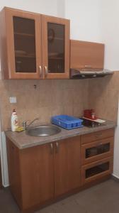 A kitchen or kitchenette at Apartmány KOS