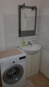 A bathroom at Apartmány KOS