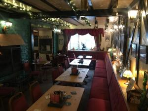 A restaurant or other place to eat at Prince of Wales Inn