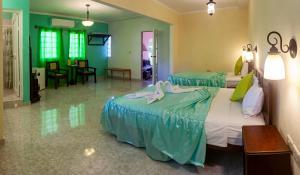 A bed or beds in a room at BR& El Ceramista