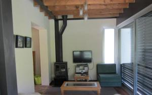 A television and/or entertainment centre at Ayios Andronikos Agrotourism House