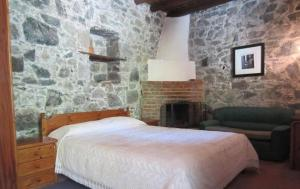A bed or beds in a room at Ayios Andronikos Agrotourism House