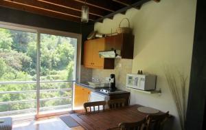 A kitchen or kitchenette at Ayios Andronikos Agrotourism House