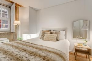 Een bed of bedden in een kamer bij Janika's Apartment