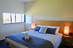 A bed or beds in a room at Troon 36 Moonah Links