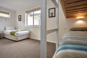 A bed or beds in a room at BIG4 Launceston Holiday Park