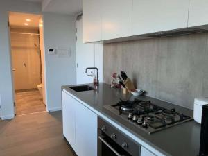 A kitchen or kitchenette at Avant Garde Living in the Heart of the City