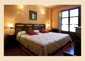 A bed or beds in a room at Casa Tia Paula