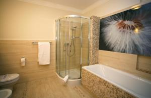 Ванная комната в Hotel Delfina