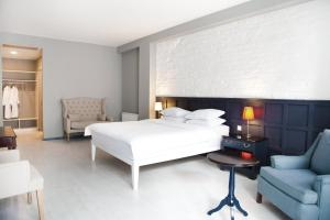 A bed or beds in a room at The Terrace Boutique Hotel