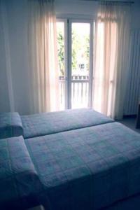 Letto o letti in una camera di Residence Dulcis In Fundo