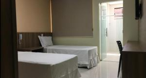 A bed or beds in a room at ALENCAR HOTEL