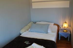 Ein Bett oder Betten in einem Zimmer der Unterkunft Gasthaus Schlossblick