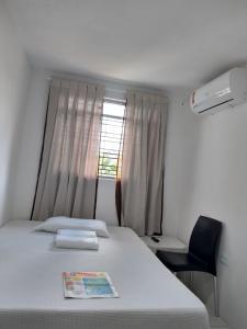 A bed or beds in a room at Quartos da Sônia