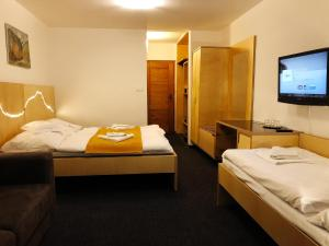 A bed or beds in a room at Hotel Diery