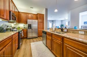A kitchen or kitchenette at Casiola Vacation Homes