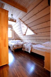 Łóżko lub łóżka w pokoju w obiekcie Willa Waja