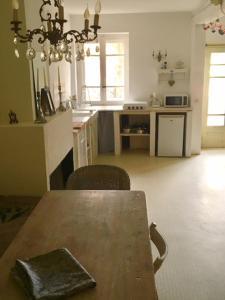 A kitchen or kitchenette at Saint Paul le Marseillais Gites