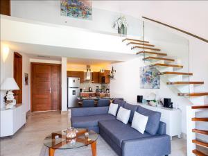 Coin salon dans l'établissement Apartment in Sublime Samana Resort