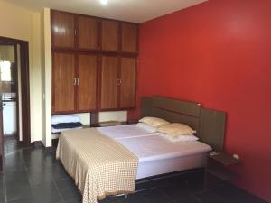 A bed or beds in a room at Residencial Ohana Porto Seguro