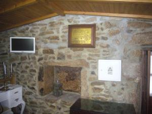A television and/or entertainment center at Casa do Monge