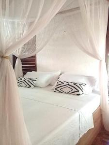 A bed or beds in a room at Herbs Guest House - Adults Only