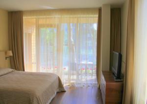 Voodi või voodid majutusasutuse Jūros Apartamentai toas