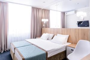 Кровать или кровати в номере Hotel Snegiri