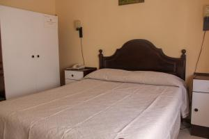 A bed or beds in a room at Telhadense