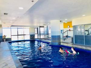 The swimming pool at or near Solaire Apartments
