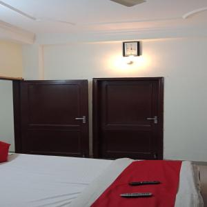 A bed or beds in a room at Paradise Villa
