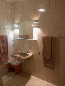 A bathroom at hotel pension steiner