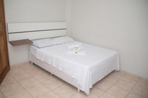 A bed or beds in a room at Pousada do Rui