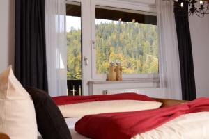 Een bed of bedden in een kamer bij Hotel Großbach