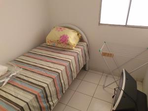 A bed or beds in a room at Casa Marechal Deodoro / Maceió / praia do Francês