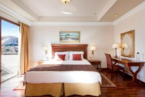A bed or beds in a room at Electra Palace Athens