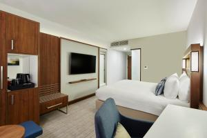 A television and/or entertainment centre at Courtyard by Marriott Luton Airport