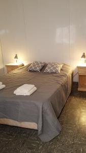 Una cama o camas en una habitación de Alquilara
