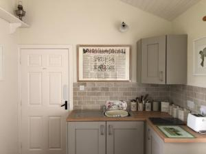 A kitchen or kitchenette at Dromard Guest Accommodation
