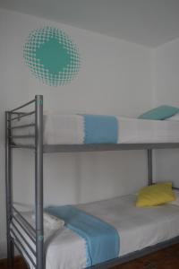 A bunk bed or bunk beds in a room at La Bartola Guesthouse