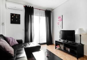 A seating area at Apartment Eva Cabo Roig
