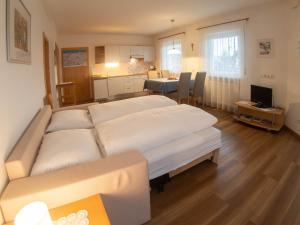 Ein Bett oder Betten in einem Zimmer der Unterkunft App. Tamanhof