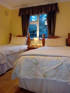 A bed or beds in a room at Corrib View Guesthouse