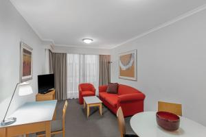 A seating area at Adina Serviced Apartments Sydney Martin Place