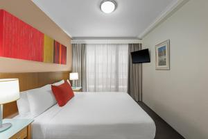 A bed or beds in a room at Adina Serviced Apartments Sydney Martin Place