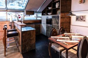 A kitchen or kitchenette at Backstage Boutique SPA Hotel