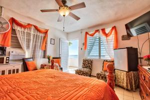 A bed or beds in a room at Coconut Palms Inn